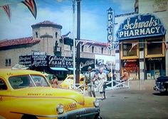 """Hollywood movies on local location often preserved views of Los Angeles' architecture and development. This is a screen shot of Jack Carson and Doris Day flagging a cab in the parking lot of Schwab's in MY DREAM IS YOURS (1949). It is an uncommon color shot of Schwab's from its west side. Across the street we can see a """"Glorifried Ham n' Eggs"""", likely the same chain as Tom Breneman's on Vine Street."""