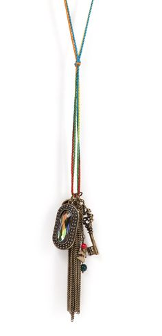 This long tassel neckpiece is multicolored and features interesting key charms for pendant. Wear with a top and jeans and flaunt a boho chic style.