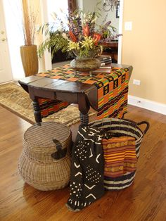 Ethnic textiles and baskets are used to create a global tablescape for an entry foyer.