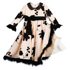 Girls pretty beige and black dress by Graci, ideal for special occasions. Made with a layer of soft and lightweight crepe, over a layer of silky fabric, tulle and a soft cotton feel lining. It is decorated with an embroidered black floral pattern, withan elegant black bead collar and a marabou feather trim around the flared hem. The black taffeta band and bow around the high waist ties at the back and matches the taffeta trims on the sleeves.