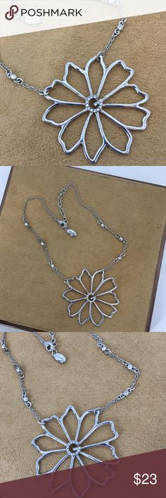 """🎉 Guess Flower Necklace This is a great addition to any outfit. See examples through out my closet. Chain stretched out measures 16.5"""" long. Flower in center of the 16.5"""" is 2 1/8"""" at its widest. Chain has three gems on each side of chain with a G of gems matching in the center of flower. In excellent preloved condition. Guess Jewelry Necklaces"""