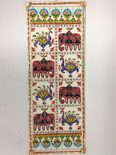 10.5x27.5 Inches Lippan kaam or Lippan work is a traditional art form from Western India and is mainly done by women of the Rabari community of Kutch, Gujrat. This mud relief work is done on the insid