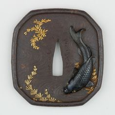 Koi carp tsuba from 1615-1868 Japan. Iron, copper-gold alloy (shakudō) with gold and copper inlay.