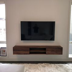 Floating TV Console with 2 Felt Lined Drawers Yu-Ching Terence Chi added a photo of their pur Floating Tv Console, Floating Tv Unit, Floating Tv Stand, Console Tv, Floating Shelves, Tv Wall Design, Tv Unit Design, Living Room Tv Unit, Living Spaces