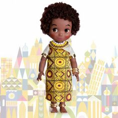 """It's A Small World Doll Collection (Hujambo) - """"This beautiful Kenyan girl in finely detailed traditional folk costume also sings in her native language! Listen to her sing 'it's a small world'' in both Swahili and English. HUJAMBO!"""""""