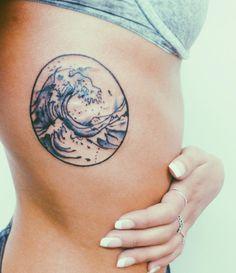 wave tattoo on ribs