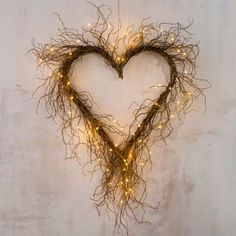 Wild and wonderful, this heart-shaped wreath is formed by an abundance of curly willow twigs. Beautiful when displayed alone, it also welcomes glowing lights and seasonal adornments.- Curly willow, metal base, floral wire- Indoor use only- Willow Wreath, Heart Wreath, Grapevine Wreath, Heart Shaped Wreath, Willow Weaving, Outdoor Wreaths, Hanging Hearts, Nature Crafts, Valentine Decorations