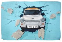 Car crosses a wall
