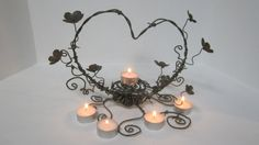 Valentine Or Wedding Centerpiece Delicate Barbed by thedustyraven, $45.00 Not too tall, candles can be replaces with candy dish and if you wanted can be placed on top of a wide spread bed of flowers.