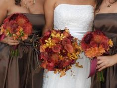 fall wedding ideas, fall wedding bouquets, fall wedding colors, autumn wedding ideas, autumn wedding bouquet, autumn wedding colors.  There are several flowers of autumn that you can choose from; they include daisies, roses, sunflowers, mums, and hypericum. To add to the fall theme you can put them in containers like hallowed-out pumpkins (real or fake), wooden boxes, or rustic lanterns.