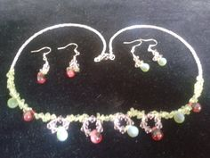 Necklace paired with 2 sets of earrings.