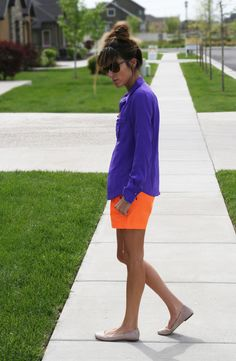 Purple top, orange shorts