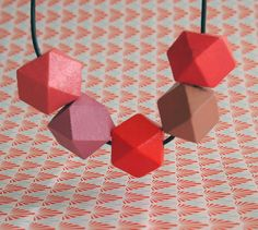 Make a unique statement with the A Comet Appears wooden geometric necklace.