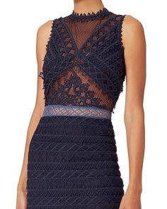 Jonathan Simkhai Organza Lace Combo Trumpet Dress: This Art Deco-inspired lace silhouette is nothing shy of extraordinary. Trumpet lace hem. Sleeveless. Back zip closure. Partially lined. Semi sheer. In navy.   Fabric: 95% polyester/5% spandex Combo: 50% polyester/50% nylon Contrast: 100% polyester   ...