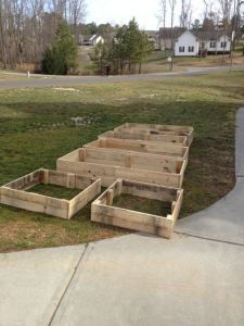 DIY Raised Garden Beds from Repurposed Pallets.... So Simple.  Pull apart the pallets.  Make a box.  Very handy that we have pallets here at work....
