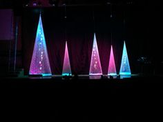 World Outreach Church Christmas stage design 2014. These trees are constructed out of string and lite with LEDs and motion lights for the color. If you would like more info on these please message me. String art trees are very inexpensive way to have an incredible WOW factor for any set design.