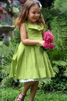 Apple-green flower girl dress - view the whole apple-green and light pink colour scheme at http://themerrybride.org/2014/03/20/apple-green-and-light-pink-wedding/