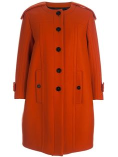 Burnt orange wool collarless coat from Burberry Prorsum featuring epaulettes, long sleeves with straps at the cuffs, belted back, black buttoned closure and pockets.