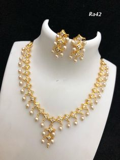 Temple jewellery available at AnkhJewels for booking msg on Pearl Necklace Designs, Gold Earrings Designs, Ruby Necklace, Short Necklace, Gold Jewelry Simple, Stylish Jewelry, Fashion Jewelry, Antique Jewellery Designs, Gold Jewellery Design