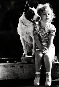 Shirley Temple with her dog Buster, 1933.