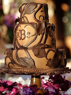 Perfect for chocolate lovers—milk chocolate fondant accented with dark choclate vines, leaves and a monogram cover this rich dark chocolate espresso cake.