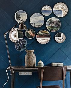 Pretty! This wall is covered with plywood strips and painted only once with dark paint. This keeps the grain partially visible. The plates are from The Little Owl. #wall #plate #blue #paint #wood #DIY