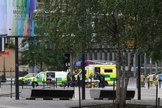 Police, ambulance crews and fire crews are seen outside the Tate Modern gallery in London on August 4, 2019 after it was put on lock down and evacuated after an incident involving a child falling from height and being airlifted to hospital. (Photo by Daniel SORABJI / AFP) (Photo credit should read DANIEL SORABJI/AFP/Getty Images)