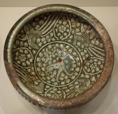 Bowl with hare and phoenixes, Sultanabad ware, Iran, Ilkhanid period, first half of 14th century, earthenware with gray englobe and undergla...