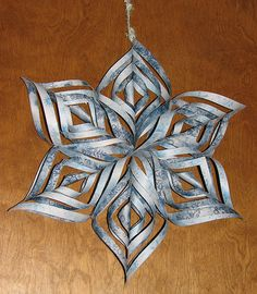 this is so cool, using crafting paper and exacto knife to make this large snowflake decoration