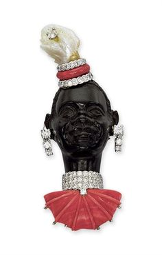A WOOD, CORAL, DIAMOND AND PEARL BLACKAMOOR BROOCH, BY CARTIER  The carved wooden face with diamond ear pendants, diamond, coral and pearl stylised turban, to the diamond and carved coral collar, 1930s, 6.1 cm high