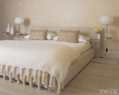 Cool contemporary chic bedroom with white oak