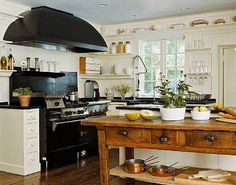 love the wood island in the otherwise white kitchen