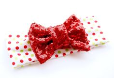 Super soft white with red and green dots turban headband. Featuring a 4.5 red sequin bow. Perfect for all ages  Sizes: Newborn- 12 inches