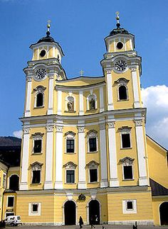 """Collegiate Church of St. Michael at Mondsee, Austria. Baroque facade ( 1736 )  The wedding of Maria and Captain Von Trapp in """"The Sound of Music"""" movie was filmed here. Photo by Nicholas Even, Dallas TX"""