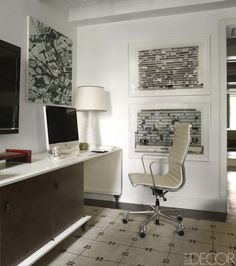 A painting by Thomas Cordell hangs above a custom-made desk; the photographs are by Filip Dujardin, and the rug is by Beauvais Carpets.