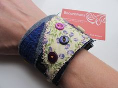 Upcycled Denim Cuff / Textile Bracelet : Blue Yellow Purple Vintage Buttons & Beads. 10.50, via Etsy.