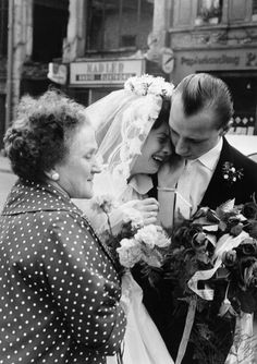The Berlin Wall was built in 1961, effectively dividing the German city in half. This photo, taken during the first year of the wall's existence, shows the bride with her parents, who resided in East Berlin and were unable to get permission to take part in their daughter's wedding in West Berlin.