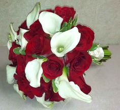 Elegant red and white bouquet with red roses and white calla lilies by wedding floral designers at Bassett Flowers and Gifts, New City, NY.