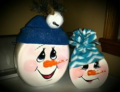 Make snowmen from old Tide Pod containers