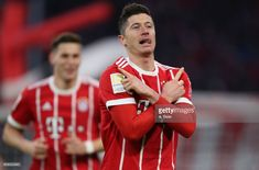 (EXCLUSIVE COVERAGE) Robert Lewandowski (R) of FC Bayern Muenchen celebrates his first goal during the Bundesliga match between FC Bayern Muenchen and Werder Bremen at Allianz Arena on January 21, 2018 in Munich, Germany. (Photo by A. Beier/Getty Images for FC Bayern)