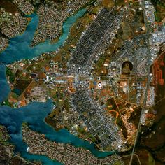 Aerial view of Brasilia - The city was founded on April 21, 1960 in order to move the capital from Rio de Janeiro to a more central location within Brazil. The design - resembling an airplane from above - was developed by Lúcio Costa and prominently features the modernist buildings of the celebrated architect Oscar Niemeyer at its center.