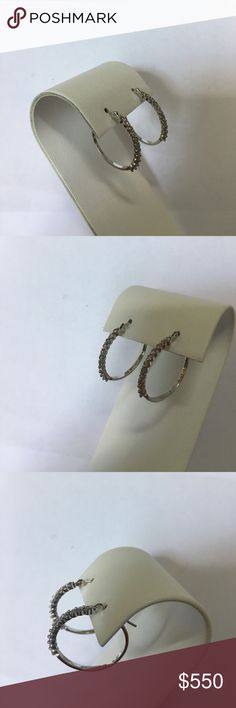 Designer 14K White Gold Diamond Hoop Earrings Stamped 14K along with the Designer's marks. Solid White Gold Diamond hoop earrings. Perfect size, go with everything. Natural, genuine, round cut Diamonds beautifully set vertically on earrings. Loved and worn, time to let them go. Price is firm, no trades. Posh Concierge service included. Jewelry Earrings