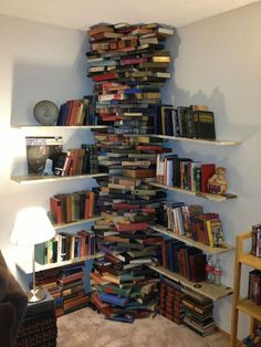 Talk about having more books than your bookshelves can hold! You'd have to be very, VERY careful to remove a book from that stack, otherwise...TIIIIIMMMMBERRRRRRRR!!!!! :-)