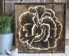 "Carnation flower ""painted"" with Minwax Jacobean wood stain on 10""x10"" wood pallet. Shading with wood stain."