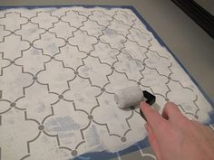 stenciled floor (Hobby Lobby stencil) for the concrete floor in an unfinished basement laundry room.