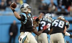 Carolina Panthers' Cam Newton (1) throws downfield against the Tampa Bay Buccaneers in the first half at Bank of America Stadium on Sunday, January 3, 2016. The Panthers won 38-10, and secured home field through the playoffs.