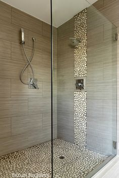 Master walk in shower modern bathroom love the river rock on the wall and tile selection..... Texun Builders