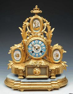 """A 19TH CENTURY FRENCH GILT METAL MANTEL CLOCK the polychrome enamel convex dial with Roman chapters, twin train Marti movement with bell strike, the ornate case mounted with three sevres type oval panels standing on a giltwood base 13"""" high"""