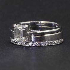 Pre-Owned Stunning 18ct White Gold Diamond Bridal Set, 1 x Diamond Solitaire Ring And 1 x Diamond Set Wedding Band. Emerald Cut Diamond Solitaire And Round Brilliant Cut Diamonds Around The Band. This Ring Can Be Viewed At Our Basildon Store Or Online At www.mallardjewellers.co.uk
