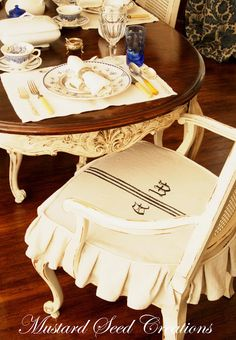 Page of several different slipcovers by Miss Mustard Seed which she has added monograms to.